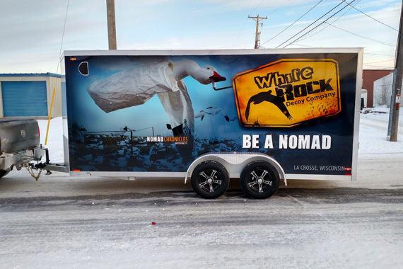 Wrap graphics on driver side of trailer for White Rock Decoy company